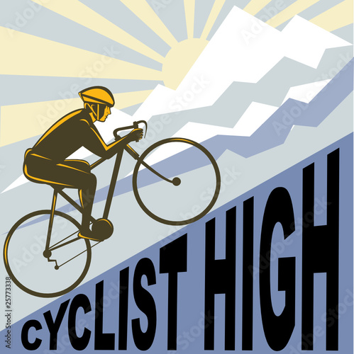 cyclist racing bike up mountain