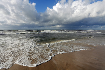 Wave crashing on a beach