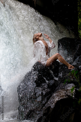 Young Woman Near The Waterfall