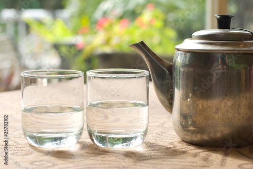 Two glass cups and steel teapot
