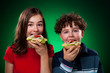 Kids eating big sandwich