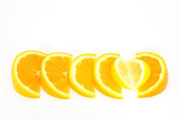orange and lemon slices lined up isolated on white