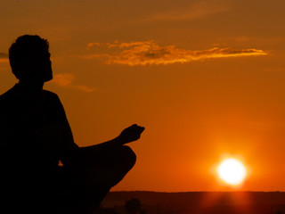 meditating at sunset
