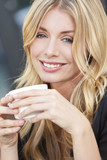 Beautiful Blond Woman Drinking Coffee