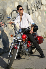 young man on a red motorcycle