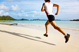 Man running on a tropical beach, seychelles