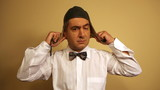 Comedian wearing bow tie acting as pilot - Humour - Fun poster