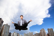 Businessman meditating in the air with yoga