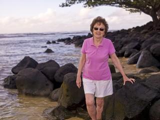 Woman On A Rocky Beach, Kauai, Hawaii, Usa