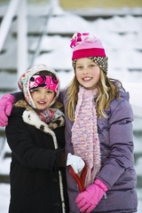 Portrait Of Two Girls In Winter Clothes