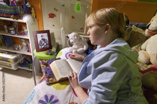 Girl Reading Bible In Bedroom