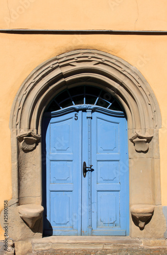 old blue door and orange wall