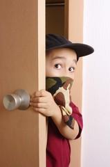 kid sneaking through door