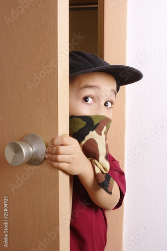 kid sneaking through door