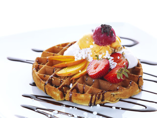 waffle with ice cream,fresh fruit and chocolate sauce