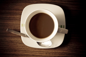 Cup of coffee over wooden background
