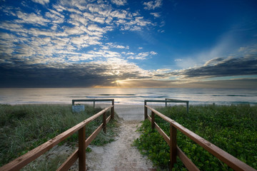 entry to beach at sunrise