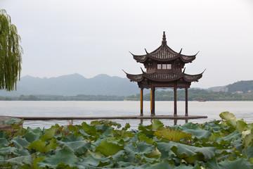 Famous West Lake in Hangzhou, China. Beautiful scene at sunrise.