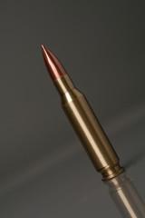 gun bullet on a grey bg