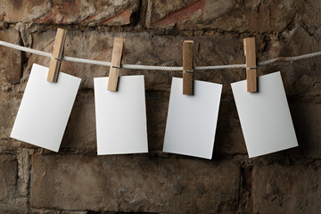 five photo paper attach to rope with clothes pins