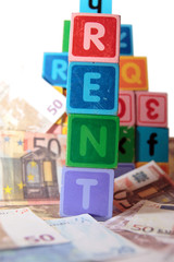 rent money in toy blocks