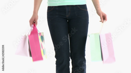 close-up of shoppings bags against a white background