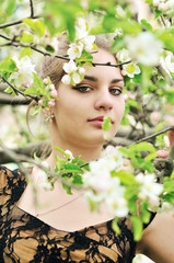 girl in blossom of tree