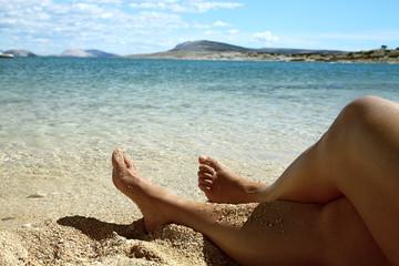 Pieds sur plage de sable