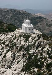 White chapel on mountain in Filote, Greece