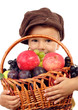 Little boy with basket of fruits, isolated on white