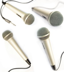 A dynamic mic with a curled cable over white..