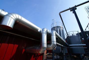 Industrial zone, Steel pipelinesagainst blue sky