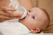 Mother feeding newborn son