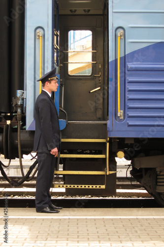 Conductor to stand beside entry in train
