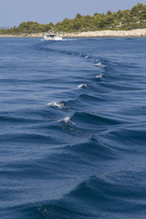 Wake caused by boat with tourists in Kornati National Park