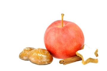 Apfel mit Zimtstange und Kekse