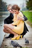 young couple near kuskovo lake poster