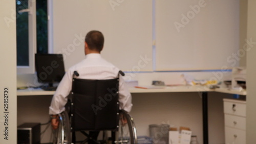 Businessman using wheelchair and PC - Disability - Business