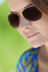 Outdoor Natural Light Portrait of Beautiful Woman In Aviator Sun