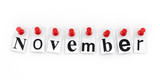November pinned to a white wall poster