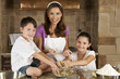 Mother, Son & Daughter Family In Kitchen Cooking & Baking