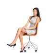 Brunette businesswoman sitting in a chair on white background