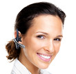 Technology - Happy young female with a bluetooth handsfree