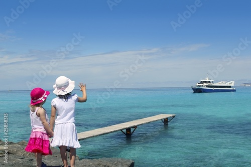 two girls tourist turquoise sea goodbye hand gesture