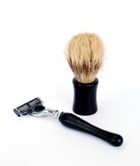 razor  and shaving brush on white background
