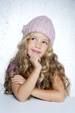 Smiling gesture little girl winter pink cap portrait