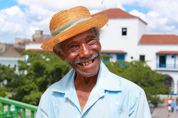 Old sympathetic cuban man with straw hat ,  Cuba