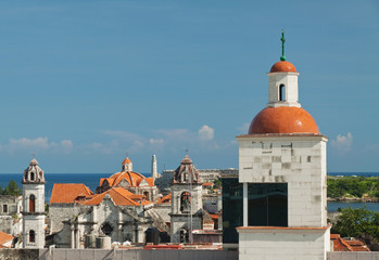 View of Havana historic center with lighthouse in El Morro Castl