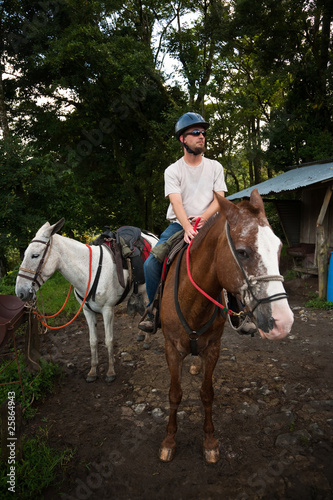 European or American man on horseback in Costa Rica