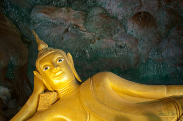 Reclining Buddha at Suwan Khu Ha Temple, Phangnga, Thailand.